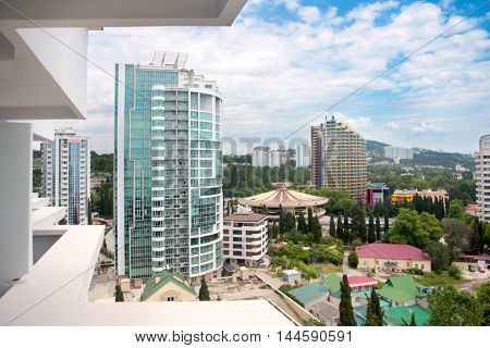 the surrounding landscape and the city of Sochi Russian buildings