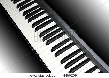 black and white piano keys as part of a musical instrument