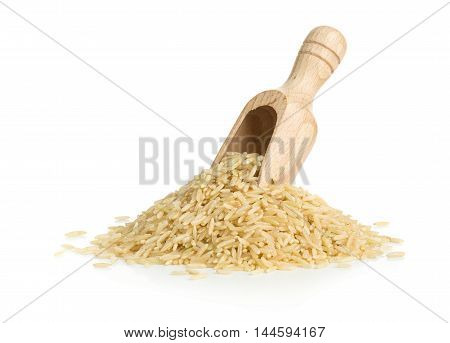 Natural brown uncooked rice in wooden scoop over white background