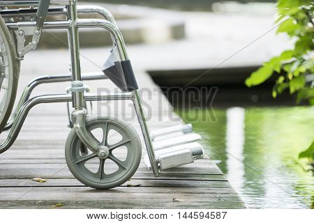 close up of empty wheelchair parked in park