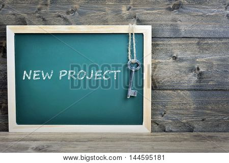 New Project text on school board and old key