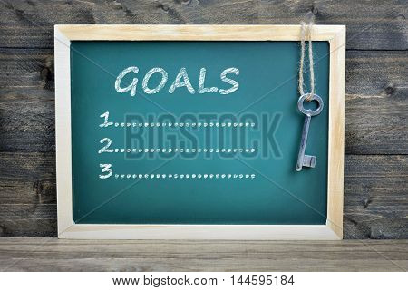 Goals text on school board and old key