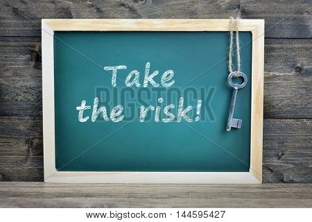 Take the risk text on school board and old key