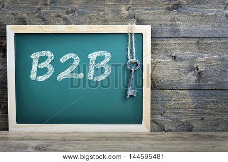 B2B text on school board and old key