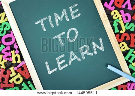 Time to Learn text on school board and magnetic letters