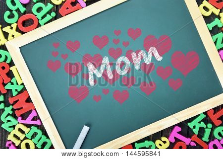Love mom text on school board and magnetic letters