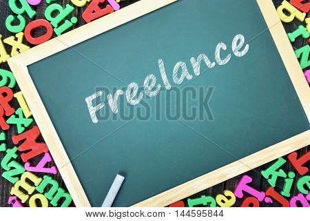 Freelance text on school board and magnetic letters