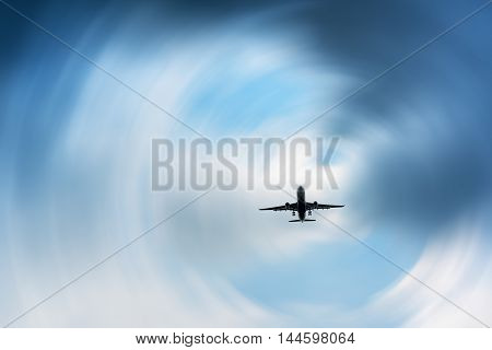 Airplane in the dark skies before storm Abstract.