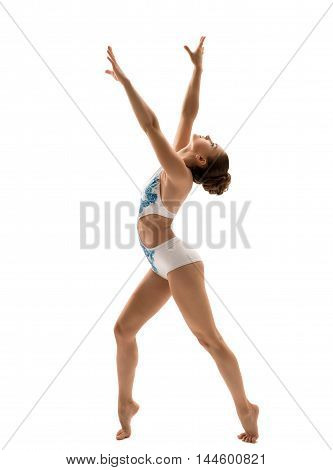 Side view of beautiful gymnast poses during workout