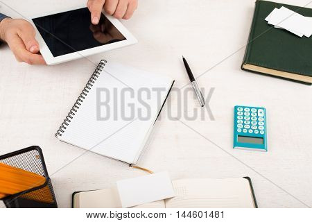 Businessman working in the home office using tablet. Home desktop