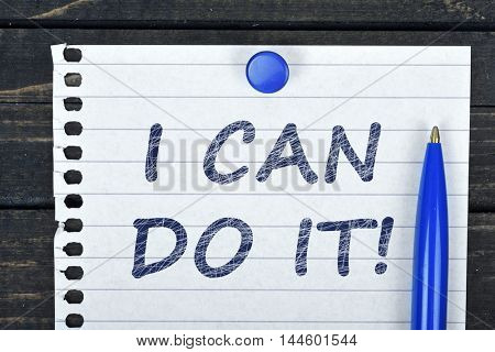 I can do it text on page and pen on wooden table