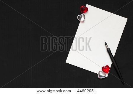 Pen and ring on paper background. Valentine's Day