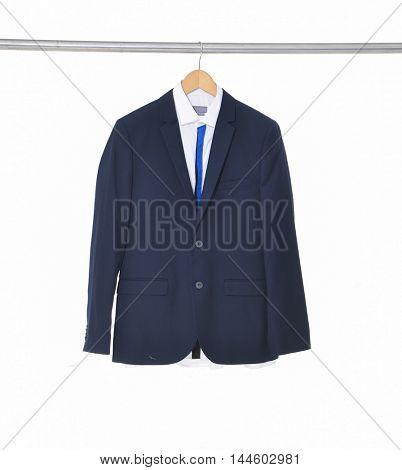 Set of male elegant suit hanging