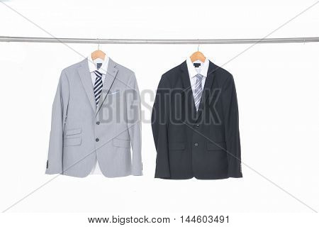 shot of two suit clothes hanging