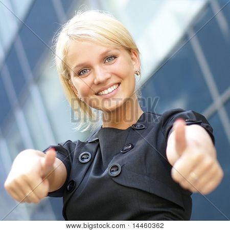 Happy businesswoman over urban background