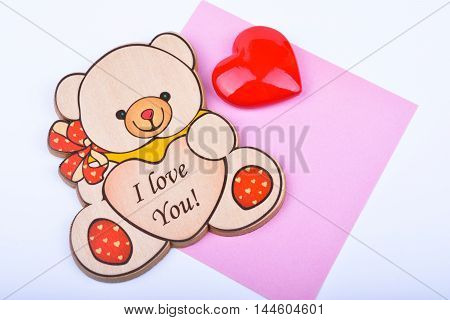 Wooden bear with text