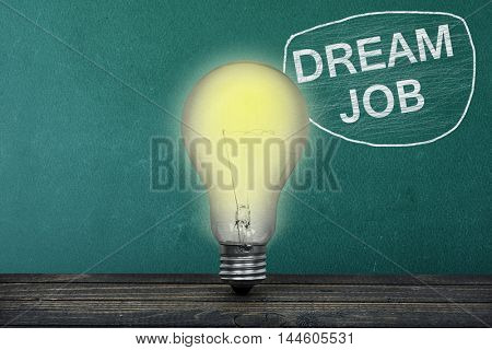 Dream Job text on green board and light bulb on table