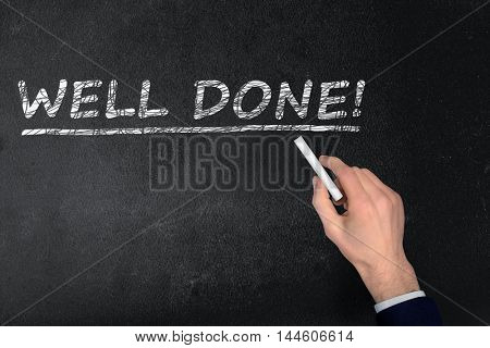 Well Done text write on black board