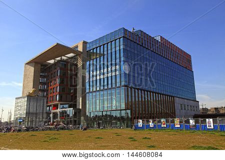 AMSTERDAM, THE NETHERLANDS - MAY 6, 2016: Amsterdam Central Library and Amsterdam Conservatory on the Oosterdokseiland Amsterdam the Netherlands.