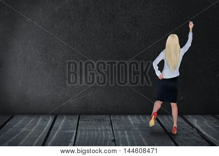 Woman about to write on an empty black board