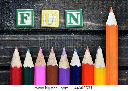 Fun text and group of pencil on wooden table