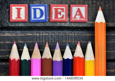 Idea text and group of pencil on wooden table