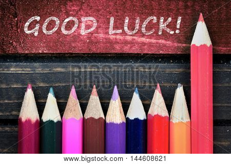 Good Luck text and group of pencil on wooden table