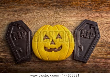 shaped cookie Halloween pumpkin and chocolate graves