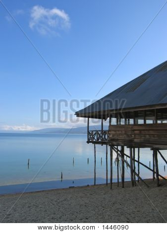 Lake With Clear Water And A House With Pile, Poso Lake, Sulawesi Island, Indonesia