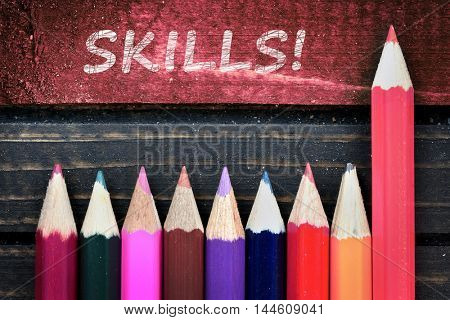 Skills text and group of pencil on wooden table
