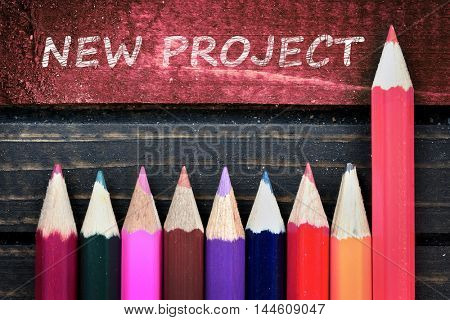 New Project text and group of pencil on wooden table