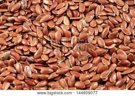 A super macro image of brown flax seeds