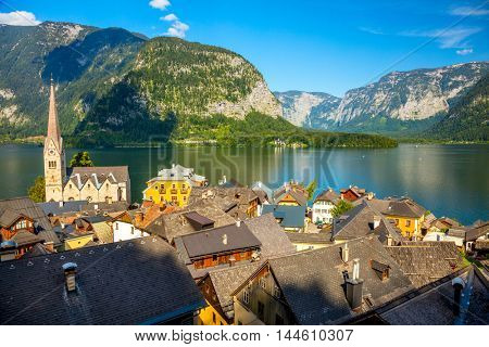Famous Hallstatt village in Alps and lake at beautiful day, old architecture, Austria, European travel