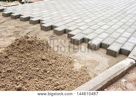construction of a new pavement of paving slabs closeup detail