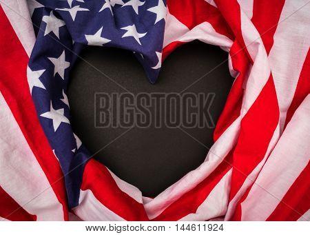 Heart shape American flag on black background .