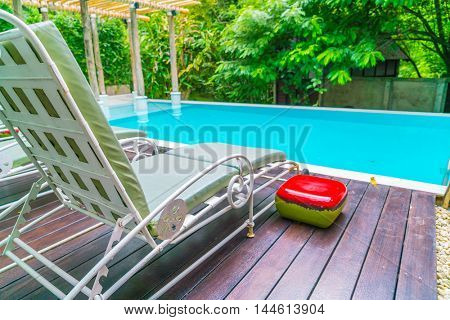 Swimming pool with relaxing seats