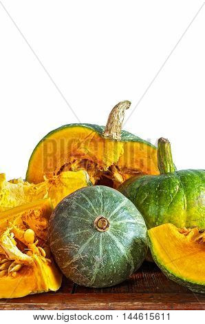 Autumn pumpkins on white background isolated. Set of different pumpkins on wooden surface.