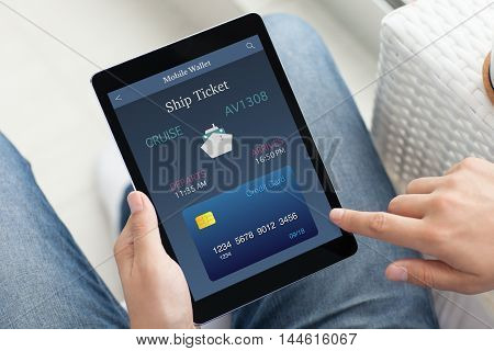man in hands holding tablet computer with online ship ticket