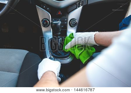 Man wearing gloves to clean the interior of the car. Auto Service.