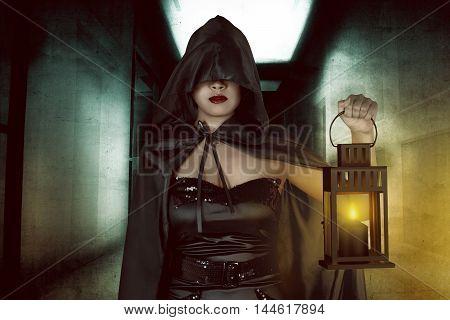 Asian Witch Woman Holding Lantern