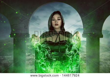 Asian Witch Woman Spelling With Concentration