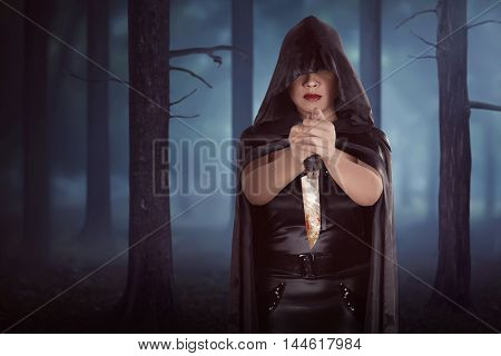 Asian Witch Woman Holding Bloody Knife