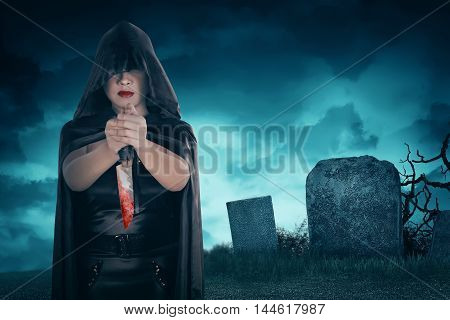 Young Asian Witch Woman Holding Bloody Knife