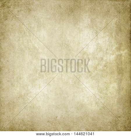 Yellowed old paper background or texture for the design.