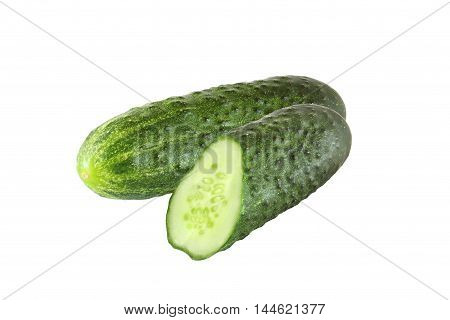 whole and sliced cucumber isolated on white background