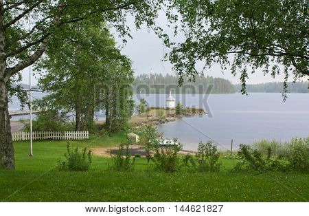 Lighthouse On The Shore Of Lake
