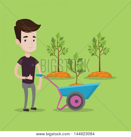 Young man pushing wheelbarrow with plant and dirt in the park. A gardener with wheelbarrow on a background of newly planted trees. Vector flat design illustration. Square layout.a