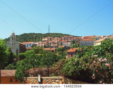Typical view of Cargese, Corsica island. Old tiled roofs and small church.