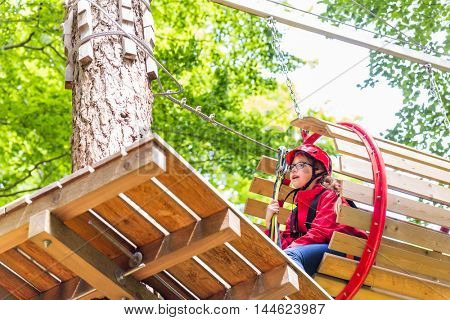 Sisters climbing in high rope course together