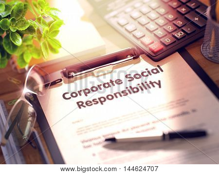 Corporate Social Responsibility on Clipboard. Wooden Office Desk with a Lot of Business and Office Supplies on It. 3d Rendering. Blurred Image.